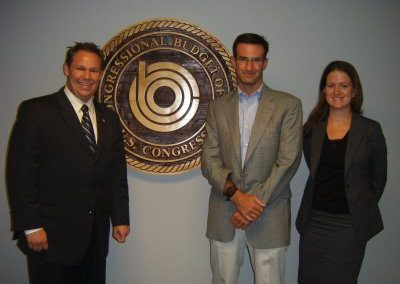 2008 Fellows Andrew Roszak and Kelly Whitener with White House Budget Director Peter Orszag